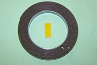 Double-Sided Adhesive Foam Tape - Yellow Backing.  Designed for automotive trim fixing.  Delayed cure allows for repositioning where required. 12mm x 5m